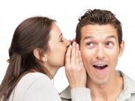 Woman whispering in a man's ear
